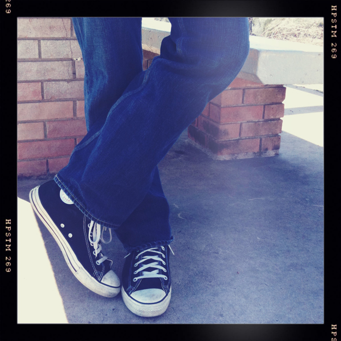 blue jeans, black converse all stars
